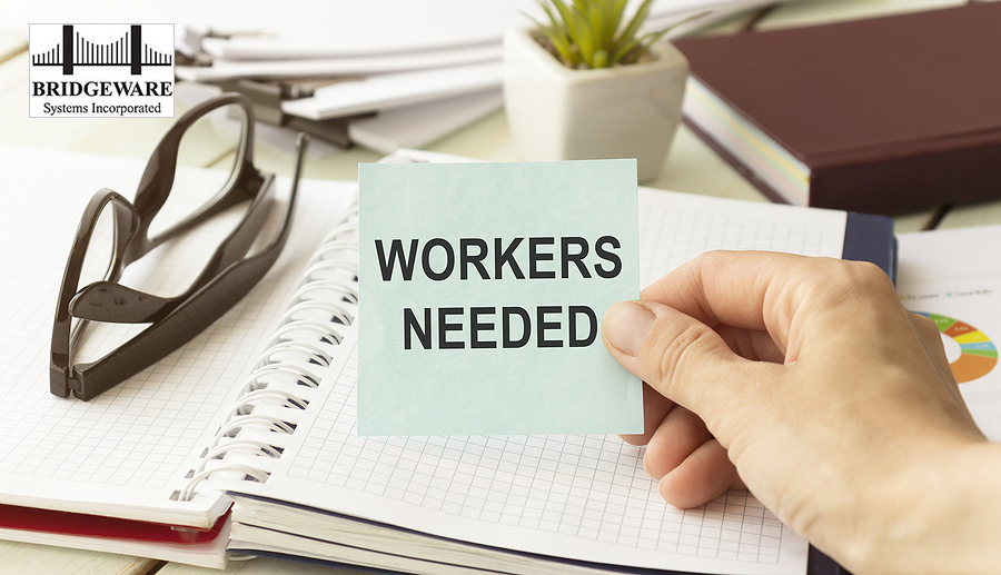 Workers Needed Text On Card Businessman Holds. Qualified Unemployed